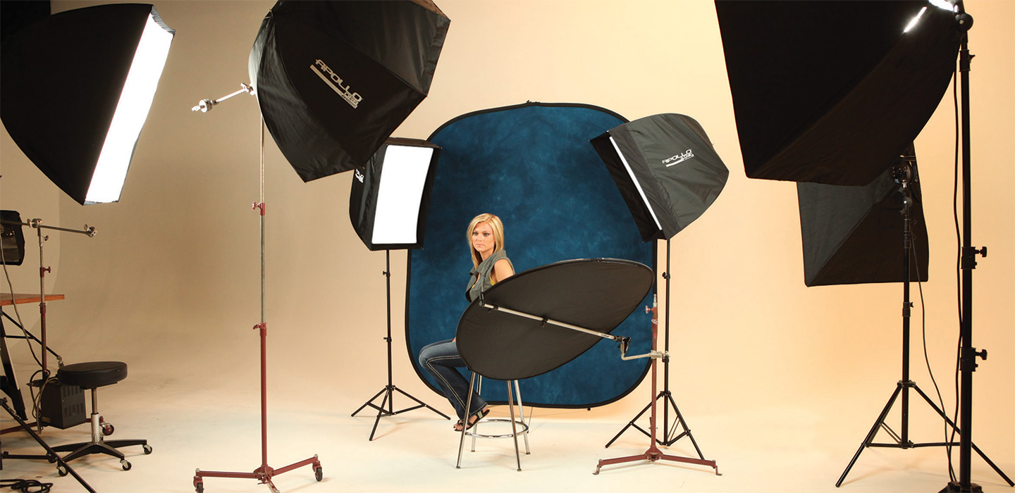Studio photography using navy blue collapsible backdrop and female model