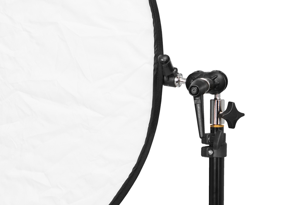 Illuminator reflector arm mounted to light stand with reflector
