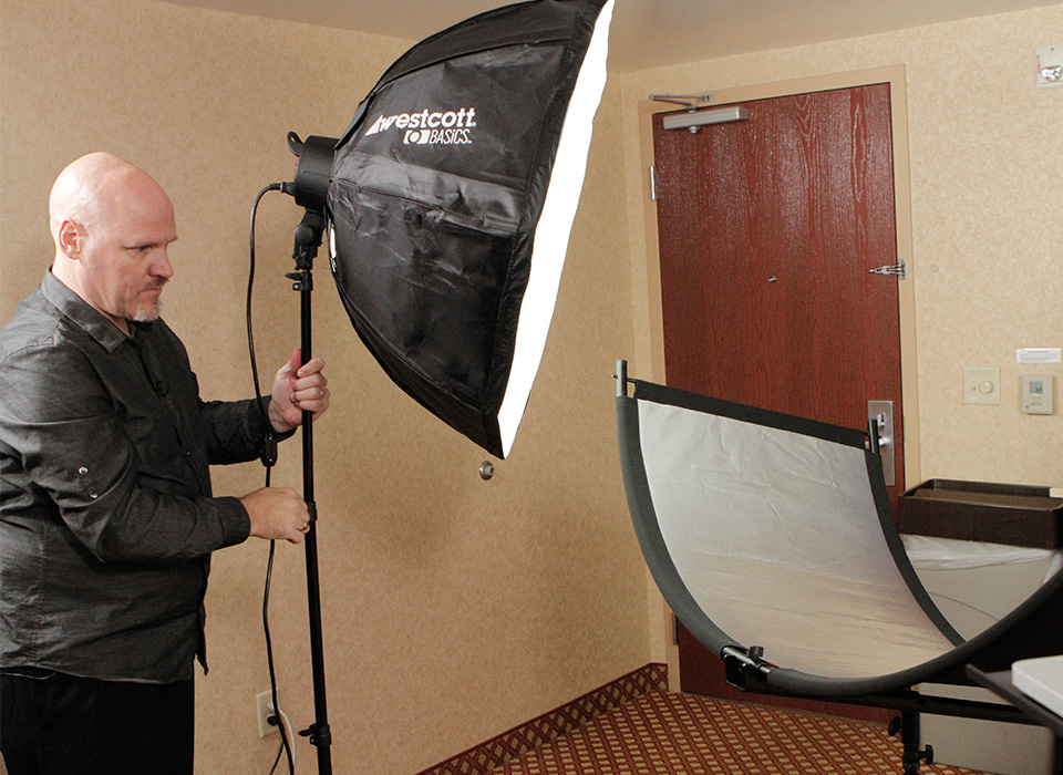 Dave Cross setting up D5 lighting kit for portrait photo shoot