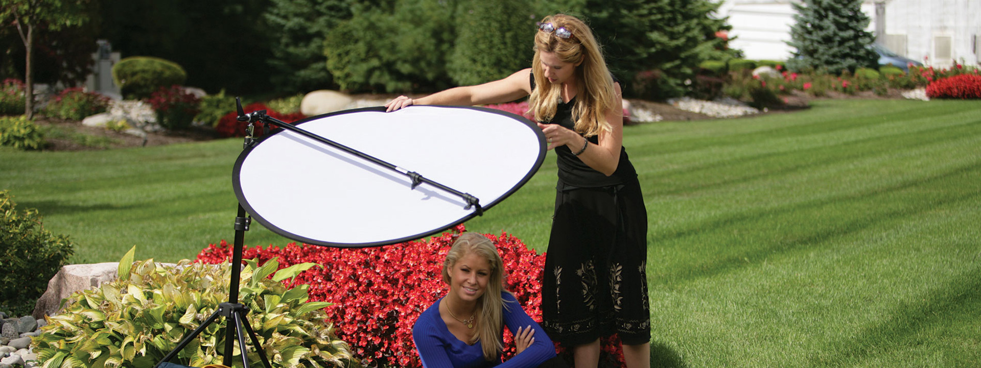 Reflector arm holder in use at a photo shoot