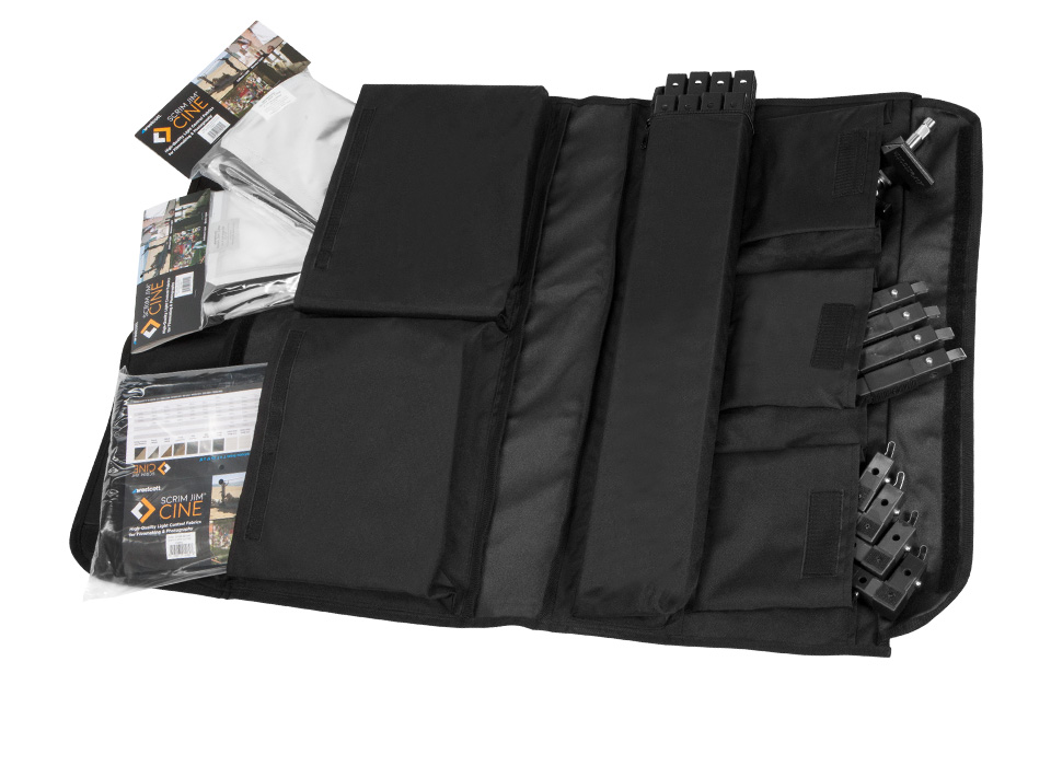 Rollable carry case opened showing various compartments filled