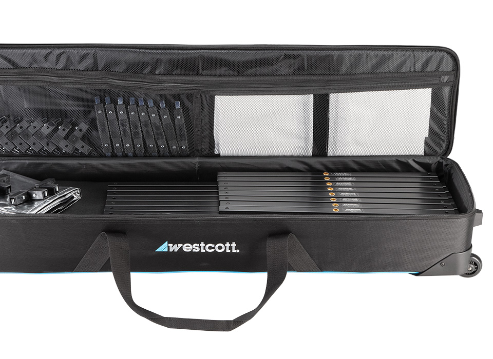 Carry case open with various compartments for lighting accessories