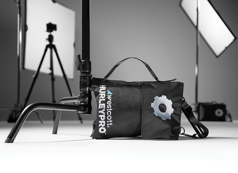 Durable weight bag being used on a photography set