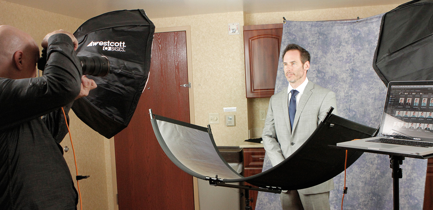 Professional office photography using cloudscape backdrop and male model