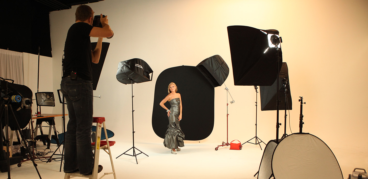 Studio photography using black collapsible backdrop and female model