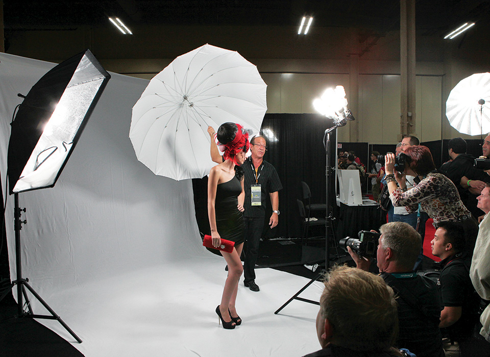 Behind the scenes photo shoot using high-key white backdrop