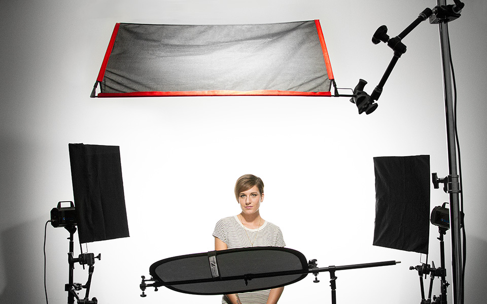 In the photo studio cutting harsh light with double net fabric