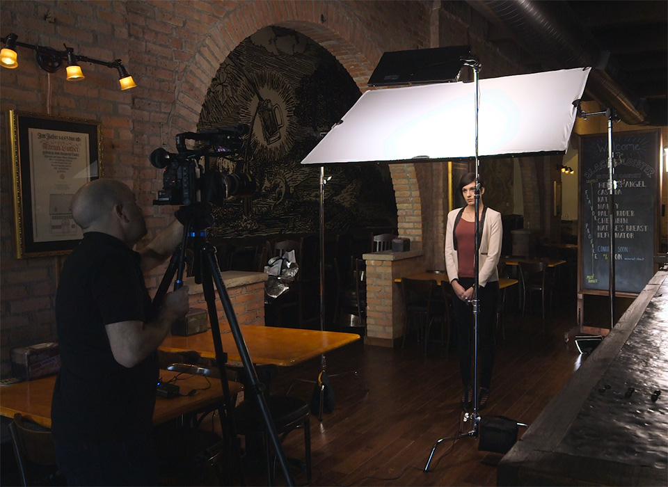 Diffusion fabric being used indoors to soften light on film set