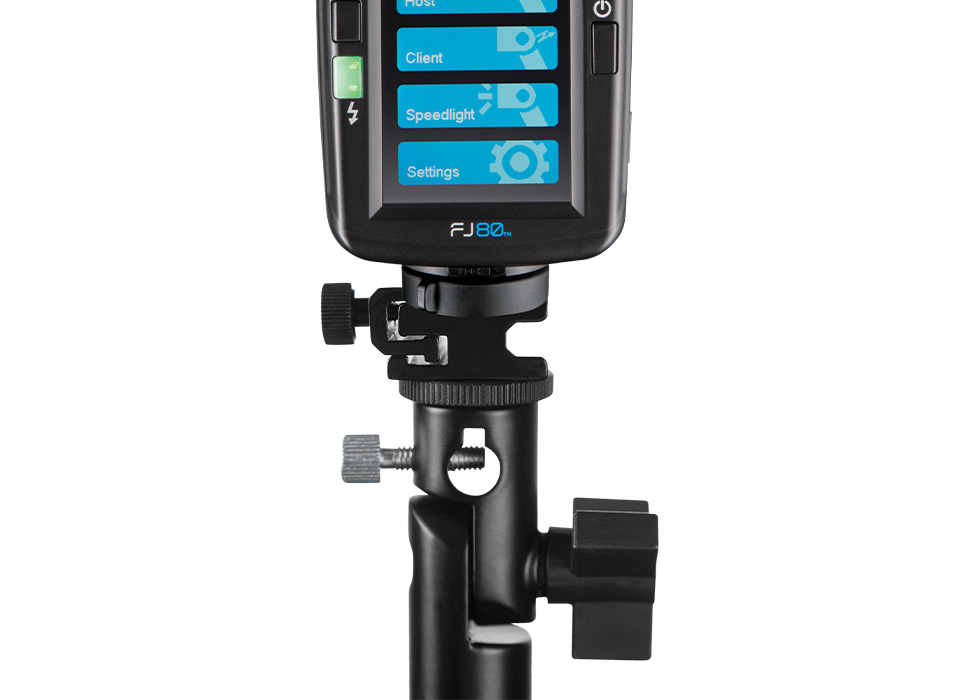 Adjustable bracket with speedlight mounted