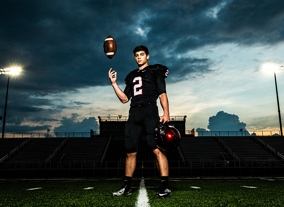Senior portrait football player lit using Zeppelin softbox