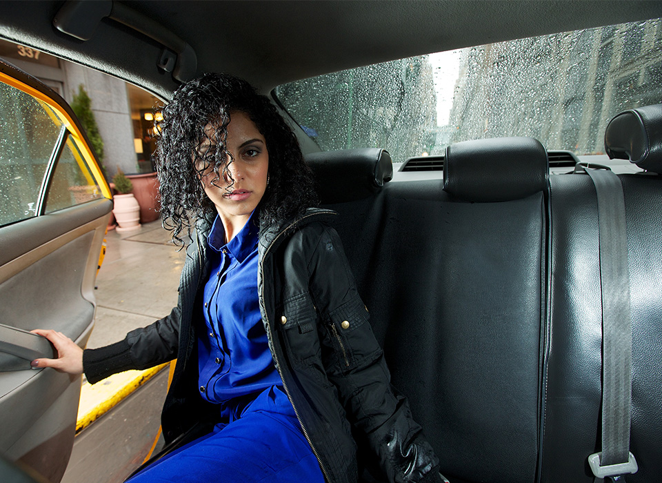 Portrait of woman in a taxi using Halo softbox lighting