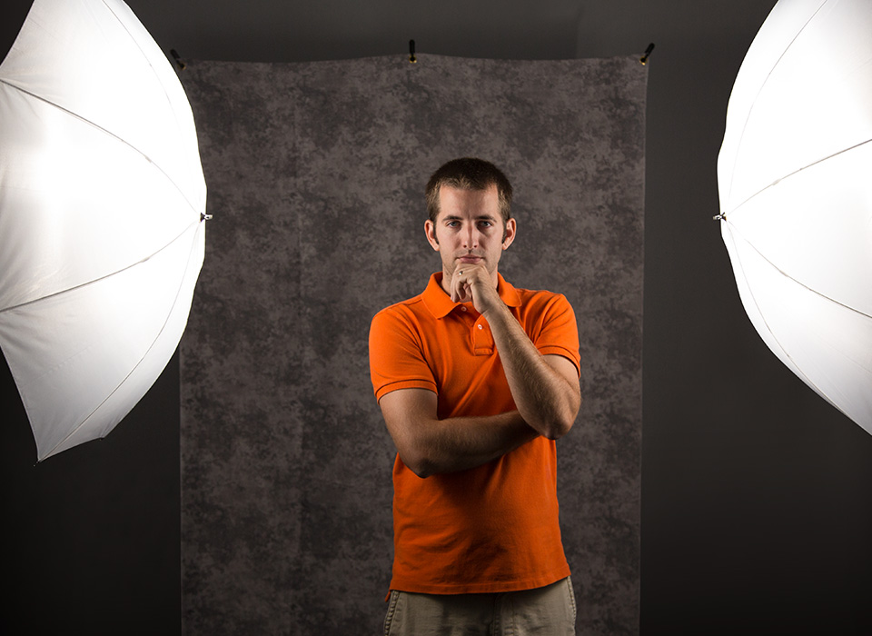 Photo lighting setup with diffusion umbrellas and continuous LED lighting