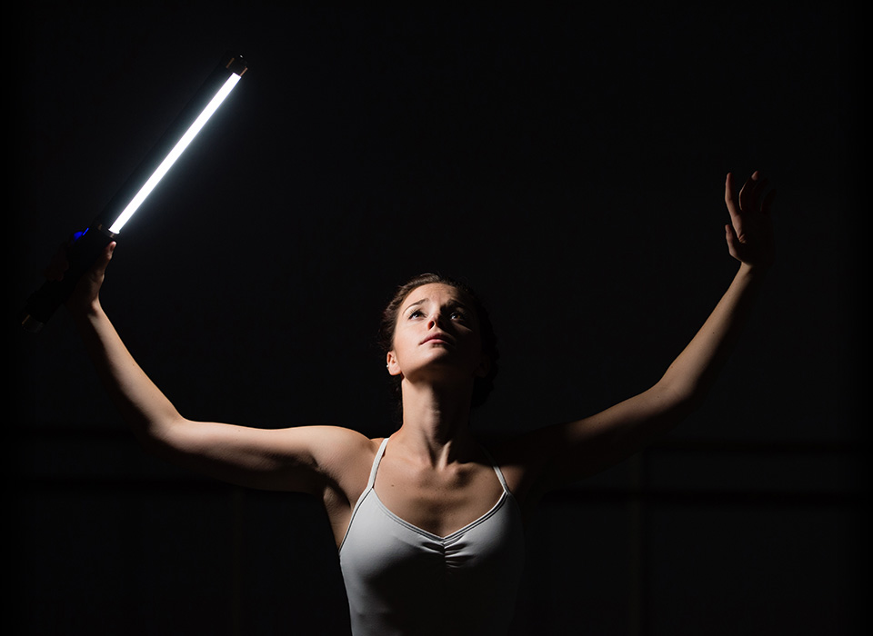 Ballet dancer model holding Ice Light 2 during photo shoot