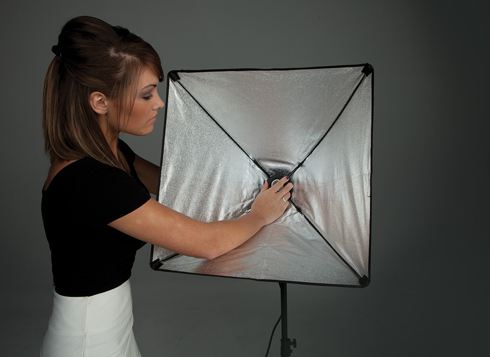 Girl attaching uLite continuous light head to softbox