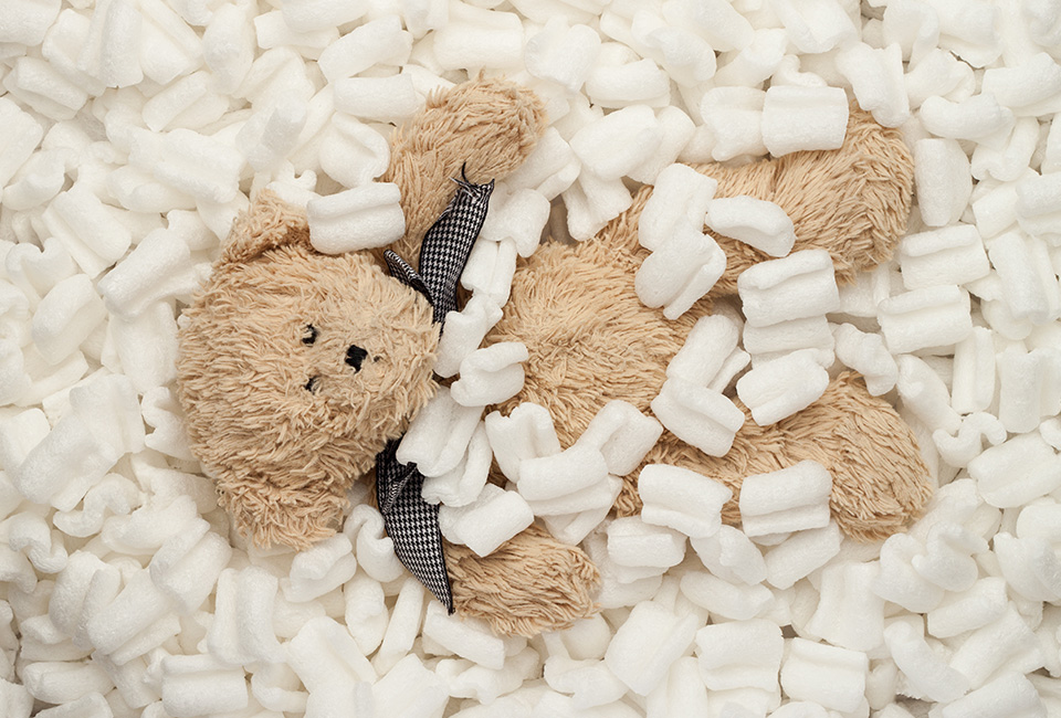 Newborn posing pillow stuffing with packing peanuts